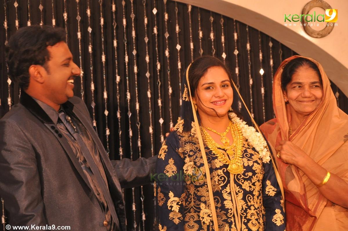 Idea star singer najim arshad wedding reception photos 00141